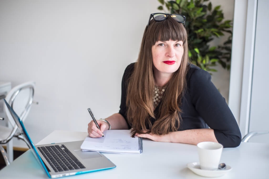 Looking for a copywriter? Image shows Katherine Wildman at her desk